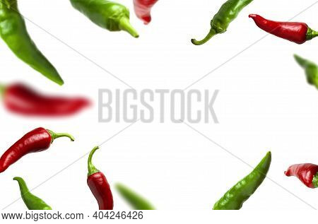 Flying Green And Red Chili Pepper Isolated On White Background. Seasoning For Dish, Fresh Hot Pepper