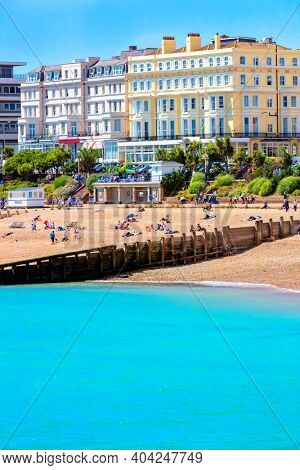 Unidentifiable people enjoy a British beach resort