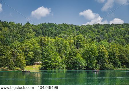 Tourists Paddling In Two Paddleboats On Emerald Green Lake In Plitvice Lakes National Park Unesco Wo