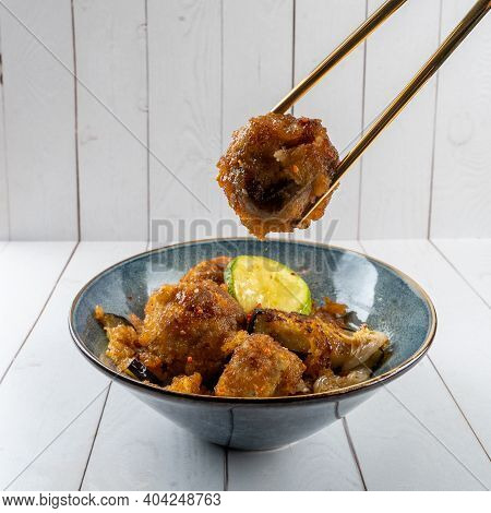 Fried Taro Vegatarian Food Cooking And Eat Withe, Good Taste Food In Thailand. Chopsticks Pick Up Fo