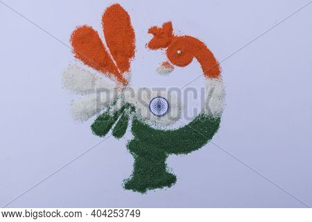 Tri Color Rangoli Of Peacock Design Drawn And Coloured On The Occasion Of Indian Republic Day With A