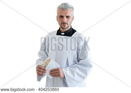Polish Catholic Priest Holding Polish Money Zloty During Pastoral Visit In Poland