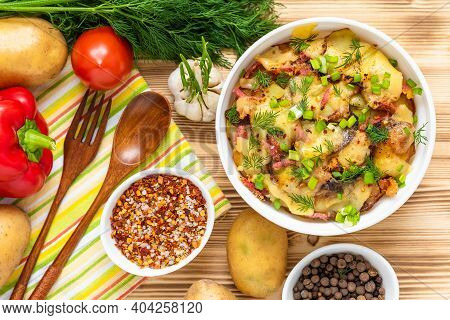 Potato Casserole On A Wooden Background With Vegetables. Top View.