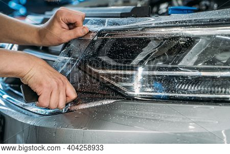 Paint Protection Film For Cars Or Anti-gravel Protection Coating Wrapping On Headlight Of New Vehicl