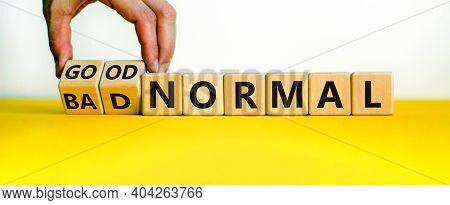 Good Or Bad Normal Symbol. Hand Turns Cubes And Changes Words 'bad Normal' To 'good Normal'. Busines
