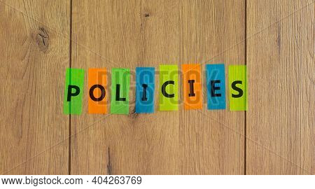Policies Symbol. Concept Word 'policies' On Colored Papers On A Beautiful Wooden Background, Copy Sp