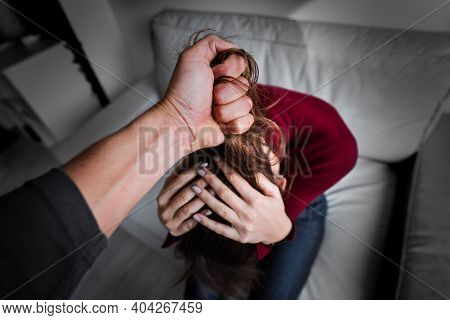 Woman Victim Of Domestic Violence. Woman In Fear Of Domestic Abuse. Man Physically Abusing His Girlf