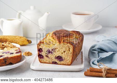 Banana Bread, Sliced Cake With Banana And Blueberries. Morning Breakfast With Tea On Light Gray Cinc