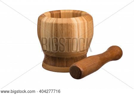 Mortar With Pestle For Grinding Made Of Natural Wood On A White Isolated Background