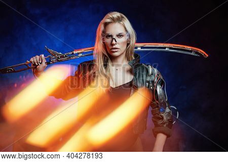 Portrait Of Martial Woman From The Future In Leather Jacket Holding Sword In Dark Background With Ra