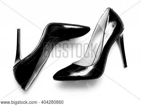 Beautiful Female Shiny Black Stilettos On A White Background