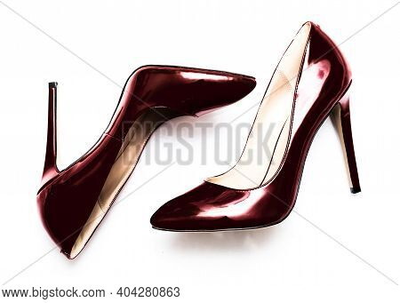 Beautiful Female Shiny Red Stilettos On A White Background