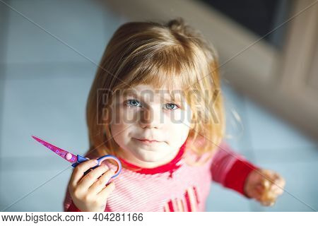 Little Cute Toddler Girl Making Experiment With Scissors And Cutting Hairs. Funny Baby Child Cuts He