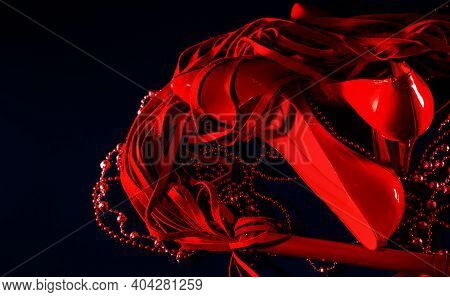 Beautiful Patent Leather Shiny Female Red Stilettos, Whip And Beads On A Black Background