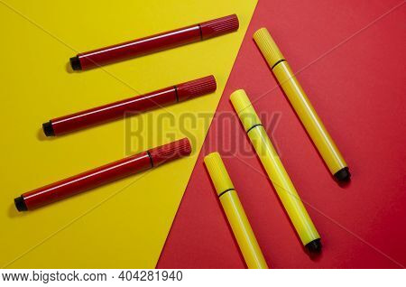 Creative Two-color Composition With Red And Yellow Felt-tip Pens. Six Colored New Felt-tip Pens On A