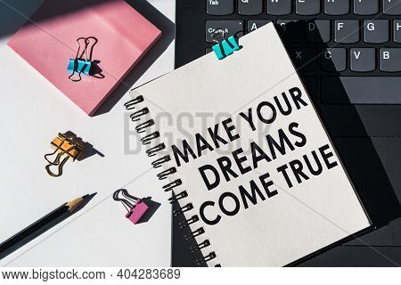 Notebook With Tools And Notes About Make Your Dream Come True Lies On Laptop.