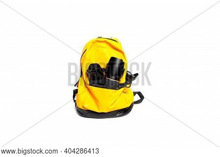 Yellow Backpack Photographer\'s Equipment , Isolated On White Background.