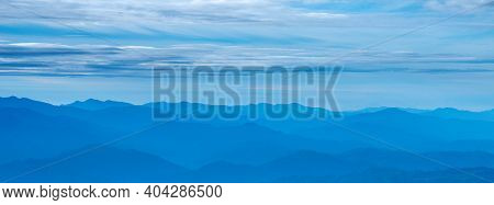 Cool Mountains Fog And Morning.blue Color Of Mountains At Sisaket Province,thailand.