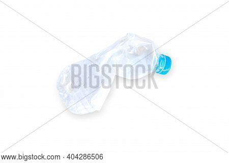 Empty And Squashed Water Bottle.close Up Of A Plastic Bottle For Recycle  Isolated  On White Backgro