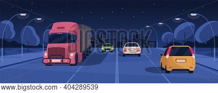 Night Driving In Lit City Street With Buildings And Lights. Panoramic View Of Nighttime Road Traffic