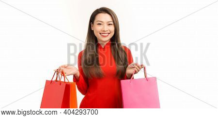 Vietnamese Woman With Ao Dai And Hold Shopping Bag