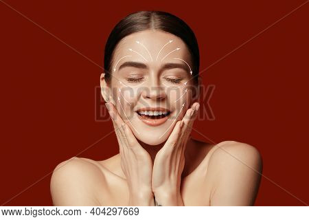 Beautiful Female Face With Lifting Up Arrows Isolated On Red Background. Concept Of Bodycare, Cosmet