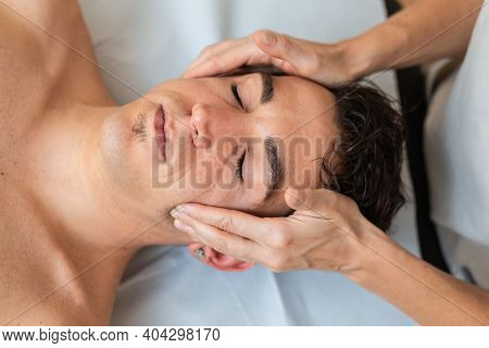 Woman Physiotherapist Does Session To Man. Manual Massage Therapy, Cervical Pain