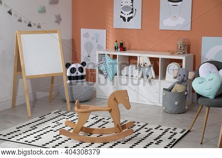 Wooden Rocking Horse And Cute Toys In Playroom. Interior Design