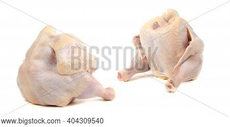 Two Chicken Carcasses Or Broilers, Isolated On A White Background. Cutting Off The Path.