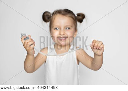 Cute Little Girl With Blonde Hair, Happy To Have Her Nose Healthy And Clean, Posing To Camera With C