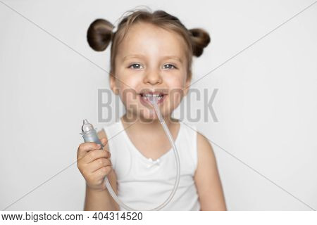 The Concept Of Medicine And Hygiene Of The Child. Childrens Nasal Aspirator. Cute Little Smiling Bab