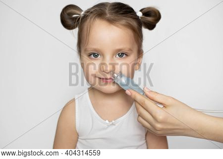 Close Up Of Mother Hand Using Nose Vacuum Cleaner Sucking Out Nasal Mucus From Nose Of Cute Adorable
