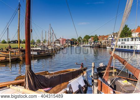 Elburg, Netherlands - August 06, 2020: Traditional Dutch Wooden Sailing Ships In The Harbor Of Elbur