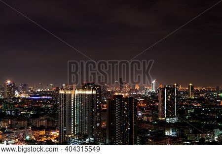 Cityscape Of Modern Building In The Night. Modern Architecture Office Building. Skyscraper With Beau