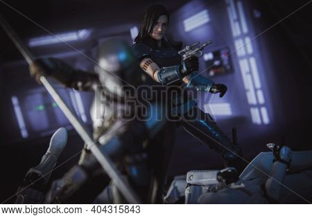 JAN 20 2021: scene from Disney Plus series The Mandalorian  battling Stormtroopers with a beskar staff with Cara Dune in focus - Hasbro action figure