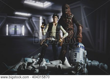 JAN 20 2021: scene from Star Wars with Han Solo, Chewbacca and droid R2D2 standing on a pile of fallen Stormtroopers  - Hasbro action figure