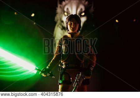JAN 20 2021: Star Wars Rebels cartoon Jedi Ezra Bridger with lightsaber and Loth Wolfs - Hasbro action figure