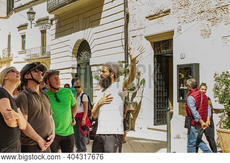 Lecce, Italy April 23, 2018 A Group Of Tourists Look Up At A Historic Building.