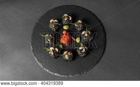 Sushi Roll With Nori, Black Rice, Crab Meat, Cucumber, Avocado, Smoked Salmon Mousse, Oar Caviar, Ma