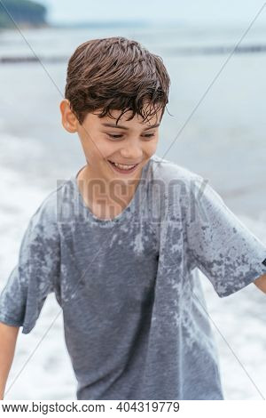 Portrait Of Teenager On The Beach. Family Vacation By The Sea. Active Lifestyle.