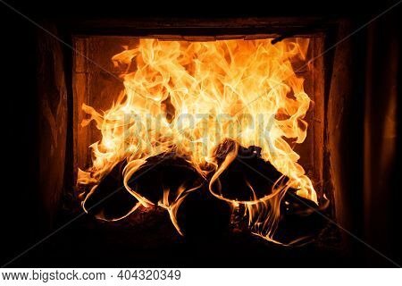 Burning Cozy Fireplace. Glowing Fire Logs. Coziness Warm Home Christmas Time