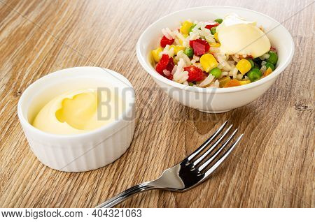 Glass Bowl With Mayonnaise, Vegetable Blend With Mayonnaise In White Bowl, Fork On Wooden Table