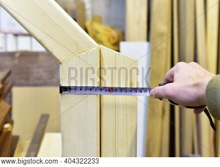 Measuring The Thickness Of A Wooden Beam Using A Construction Tape. Woodworking Industry And Furnitu