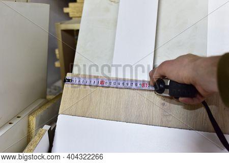Measuring The Width Wooden Panel Using A Construction Tape. Medium Density Fiberboard Mdf . Woodwork