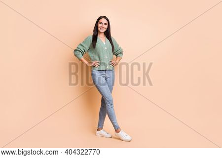 Full Length Photo Of Pretty Joyful Young Lady Hold Hands Waist Beaming Smile Isolated On Beige Color