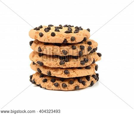 Stack Of Round Baked Cookies With Chocolate Pieces Isolated On White Background, Close Up
