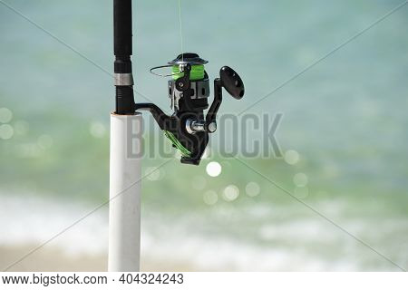 Summer Vacation. Fishing Rod At Sea. Spinner, Fish-rod. Relaxing Seascape