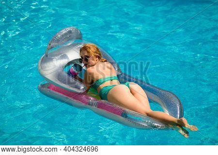 Sexy Summer Woman Butt. Girl Buttocks In Bikini. Summertime Woman On Inflatable Mattress