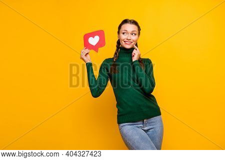 Portrait Of Lovely Cheerful Curious Girl Holding In Hands Paper Card Like Thinking Isolated On Brigh
