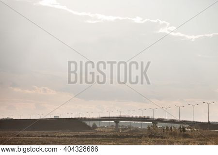 Rural Landscape With A Newly Built Freeway Motorway Road With Traffic Passing By Over A Concrete Bri
